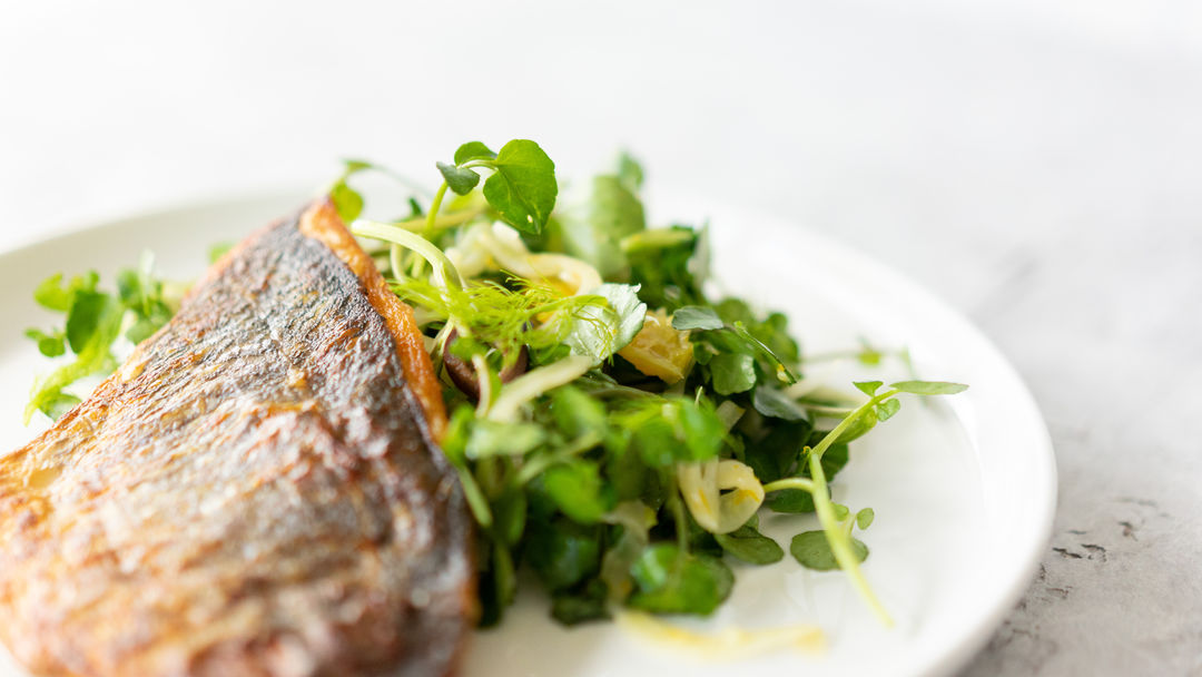 Cooked fish and watercress
